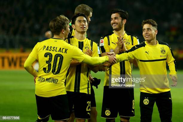 Felix Passlack Shinji Kagawa Nuri Sahin and Mikel Merino Zazon of Dortmund celebrate after winning 30 the Bundesliga match between Borussia Dortmund...