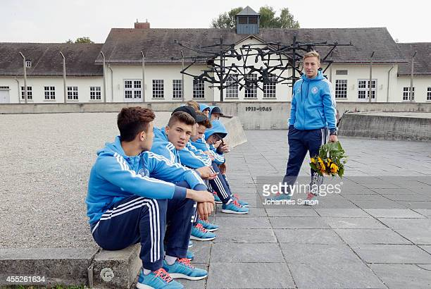 Felix Passlack Team captain of the U17 German national football team holds flowers ahead of a memorial ceremony during a visit of KOMM MIT tournament...