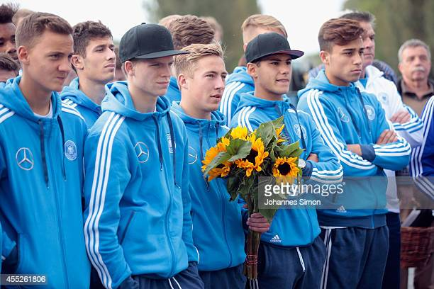 Felix Passlack Team captain of the U17 German national football team holds flowers for memorial ceremony during a visit of KOMM MIT tournament...