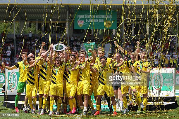 Felix Passslag celebrates with the trophy after the Bjuniors German championship final between VfB Stuttgart and Borussia Dortmund at mechatronik...