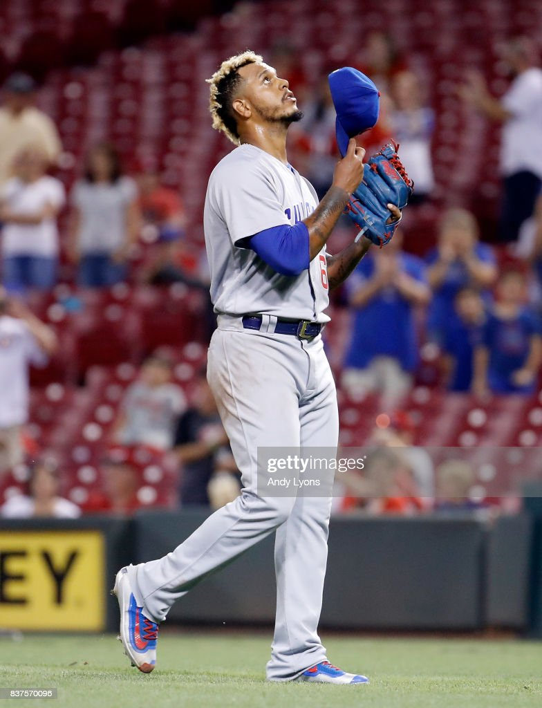 Felix Pena #60 of the Chicago Cubs looks upward after the final out of the 13-9 win over the Cincinnati Reds at Great American Ball Park on August 22, 2017 in Cincinnati, Ohio.
