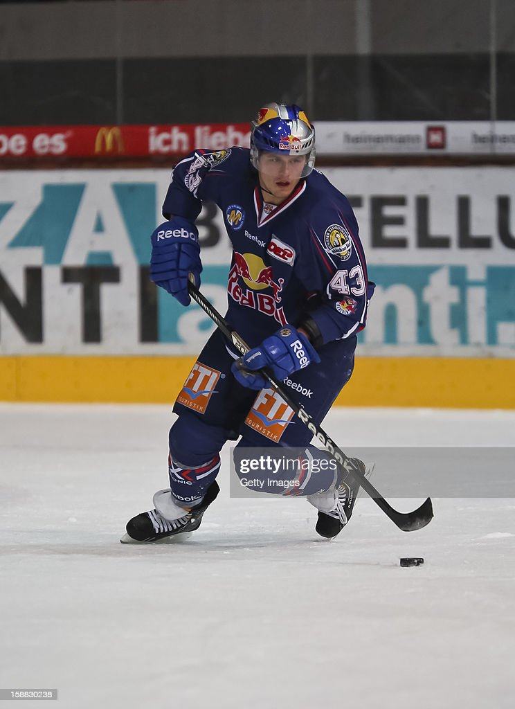 <a gi-track='captionPersonalityLinkClicked' href=/galleries/search?phrase=Felix+Petermann&family=editorial&specificpeople=852940 ng-click='$event.stopPropagation()'>Felix Petermann</a> of Red Bull Muenchen during the DEL ice hockey game between EHC Red Bull Muenchen and Hamburg Freezers at Olympia Eishalle on December 28, 2012 in Munich, Germany.
