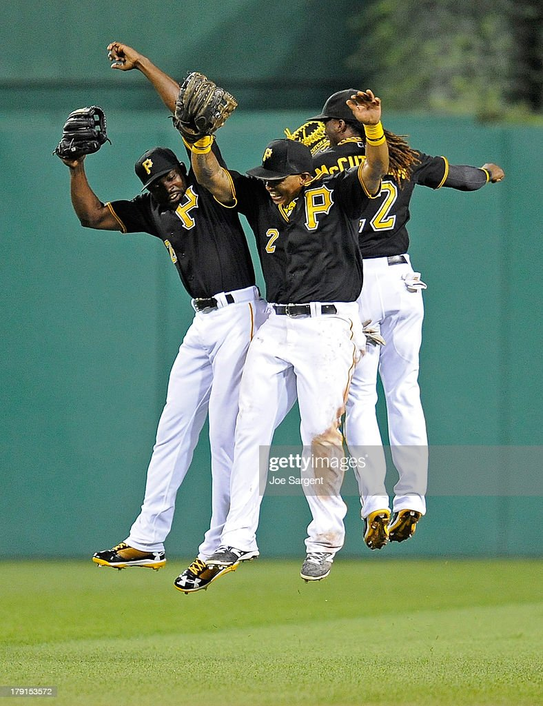 Felix Pie #26, Marlon Byrd #2, and Andrew McCutchen #22 of the Pittsburgh Pirates celebrate after a 7-1 win over the St. Louis Cardinals on August 31, 2013 at PNC Park in Pittsburgh, Pennsylvania.