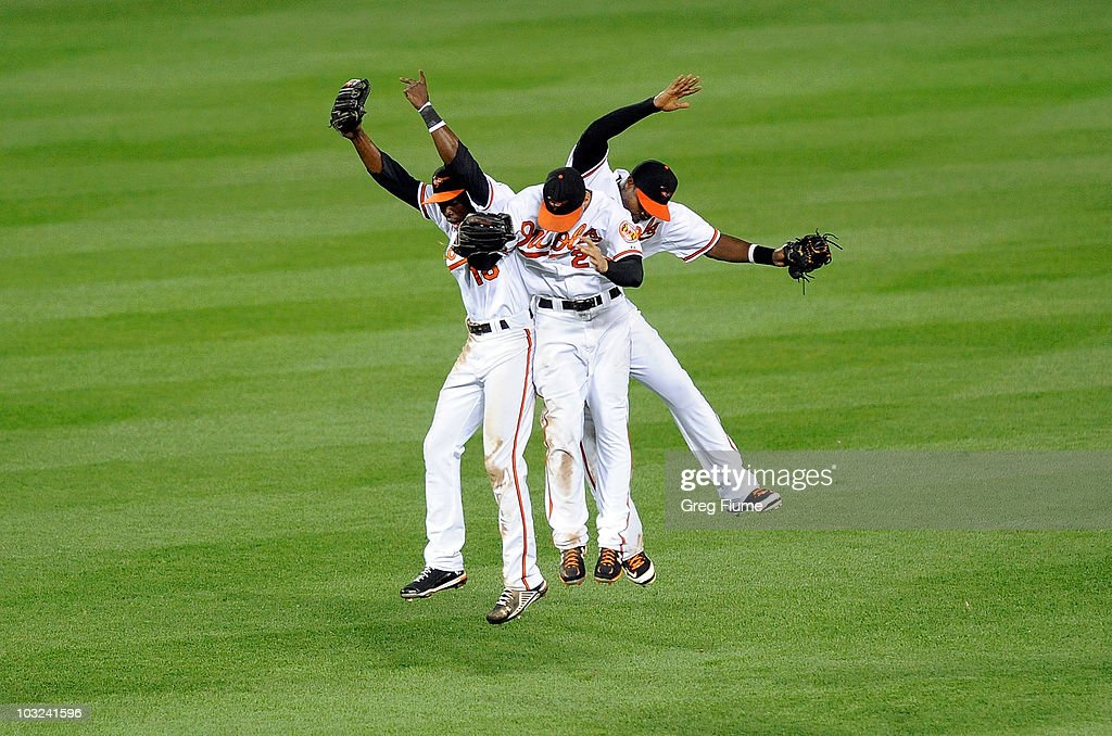 Felix Pie Nick Markakis and Adam Jones of the Baltimore Orioles celebrate after a 97 victory against the Los Angeles Angels of Anaheim at Camden...