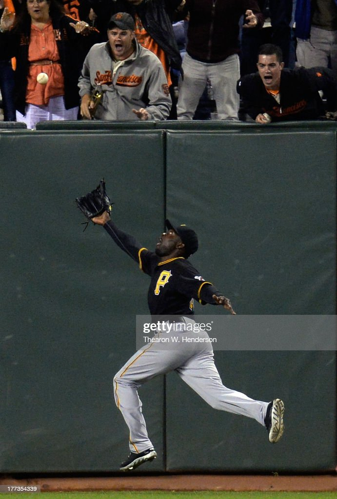Felix Pie #26 of the Pittsburgh Pirates can't come up with this bases-loaded, deep fly ball off the bat of Brandon Crawford (not pictured) of the San Francisco Giants, bouncing in the stands for a ground-rule double in the bottom of the eighth inning at AT&T Park on August 22, 2013 in San Francisco, California. The double drove in Pablo Sandoval and Brett Pill.