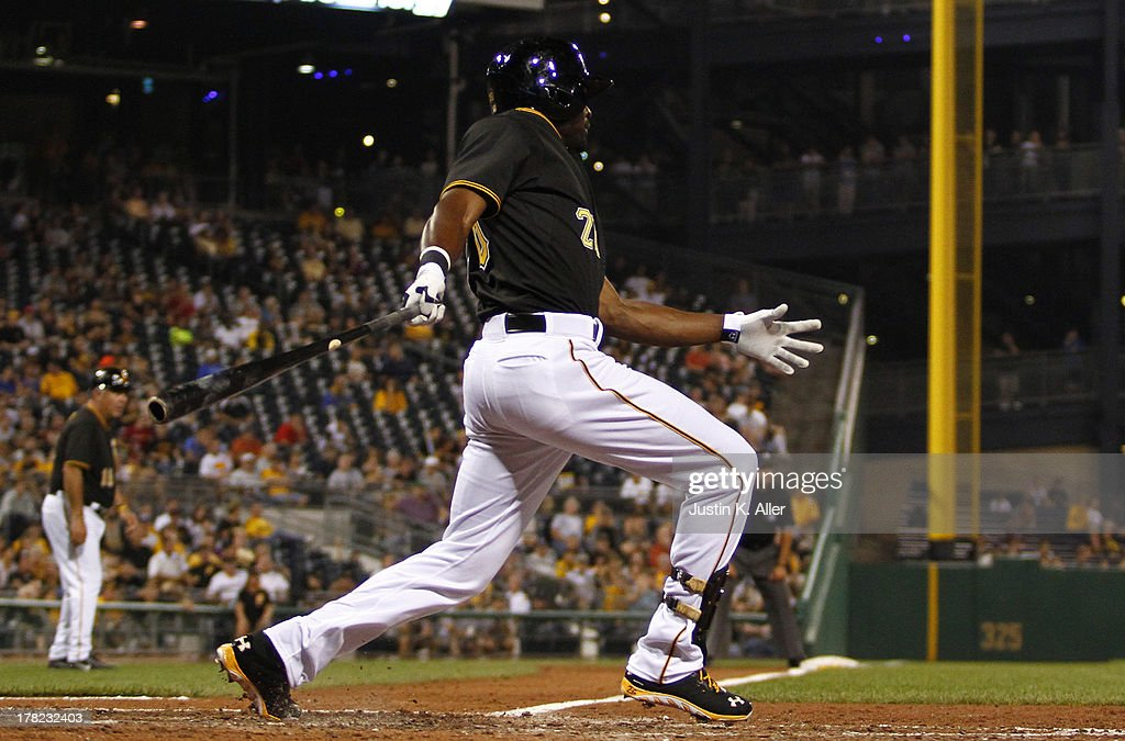 Felix Pie #26 of the Pittsburgh Pirates hits an RBI sinlge in the sixth inning against the Milwaukee Brewers during the game on August 27, 2013 at PNC Park in Pittsburgh, Pennsylvania.