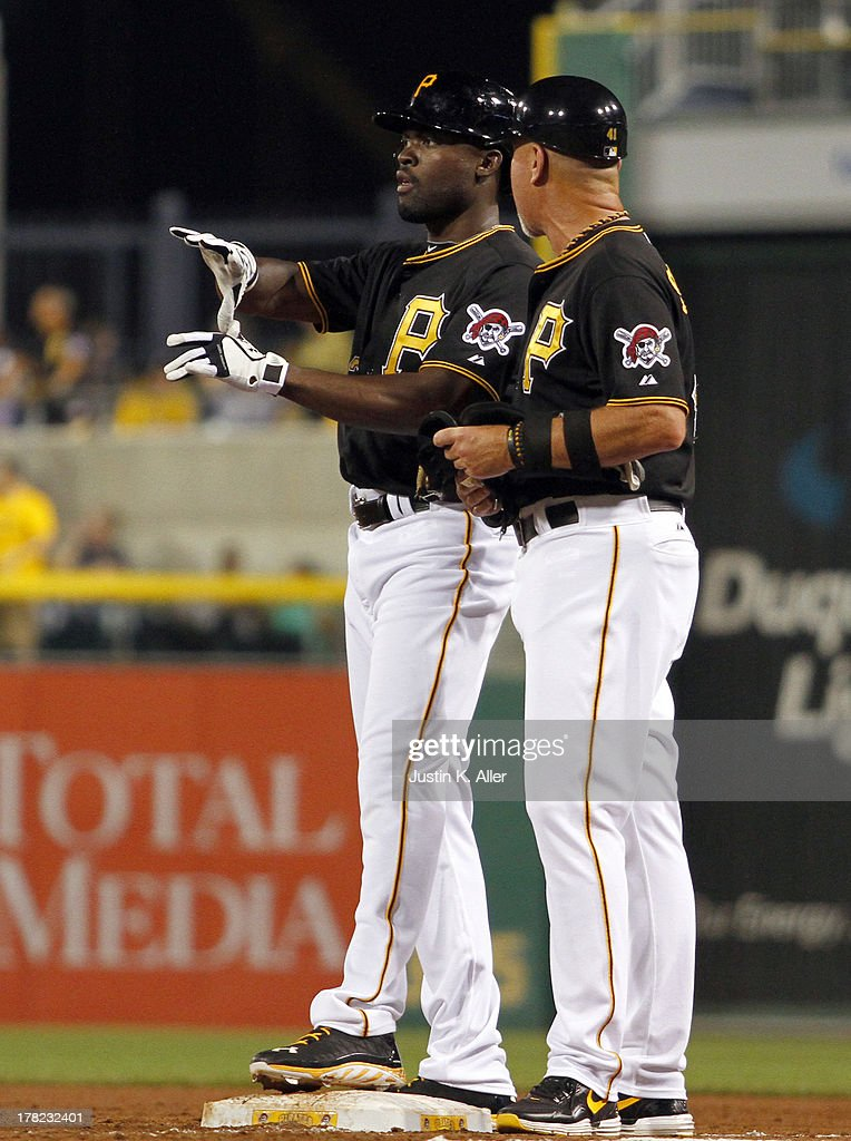 Felix Pie #26 of the Pittsburgh Pirates reacts after hitting a game tying RBI single in the sixth inning against the Milwaukee Brewers during the game on August 27, 2013 at PNC Park in Pittsburgh, Pennsylvania.