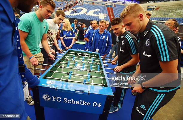 Felix Platte and Maurice Multhaup play table football with fans during the general assembly of FC Schalke 04 at VeltinsArena on June 28 2015 in...