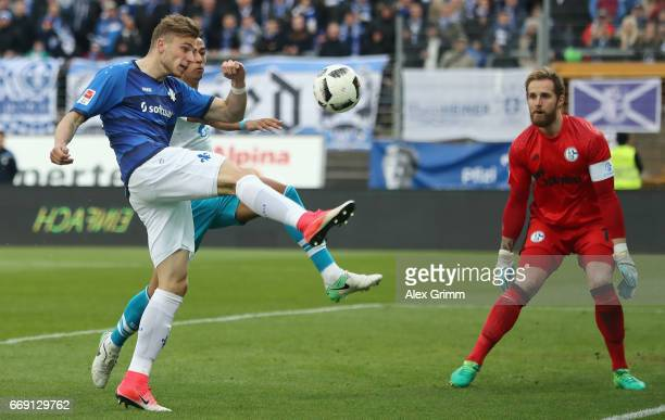 Felix Platte of Darmstadt attempts to score against Thilo Kehrer and goalkeeper Ralf Faehrmann of Schalke during the Bundesliga match between SV...