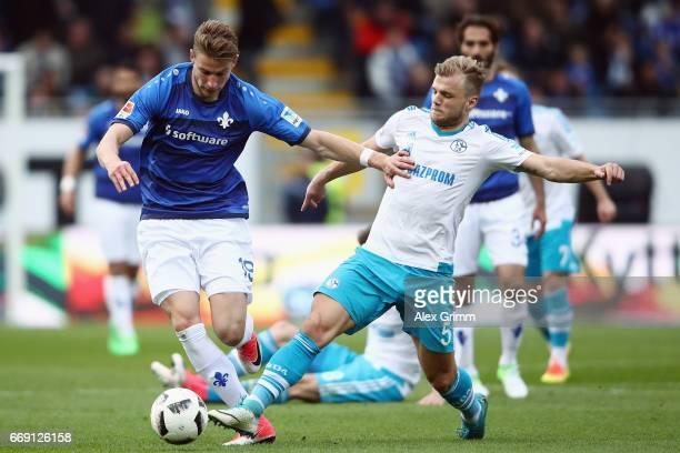 Felix Platte of Darmstadt is challenged by Johannes Geis of Schalke during the Bundesliga match between SV Darmstadt 98 and FC Schalke 04 at Stadion...