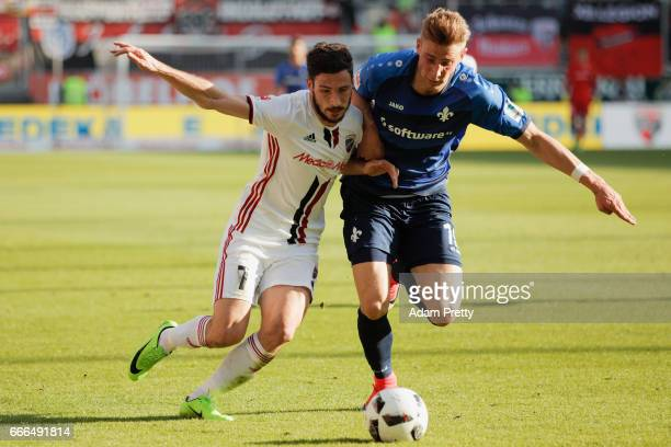 Felix Platte of Darmstadt is challenged by Mathew Leckie of Ingolstadt during the Bundesliga match between FC Ingolstadt 04 and SV Darmstadt 98 at...