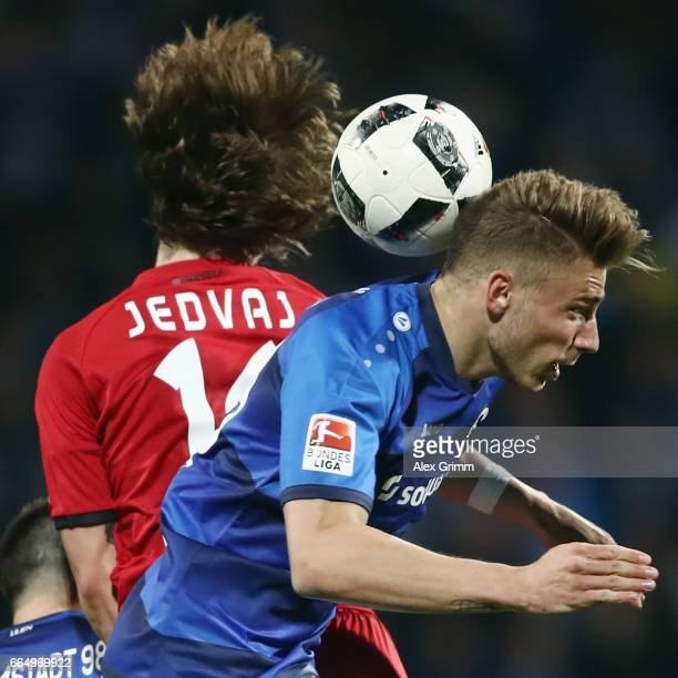 Felix Platte of Darmstadt jumps for a header with Tin Jedvaj of Leverkusen during the Bundesliga match between SV Darmstadt 98 and Bayer 04...
