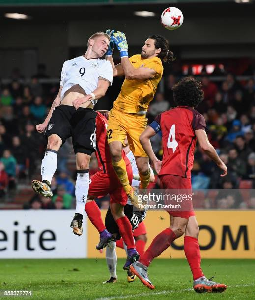 Felix Platte of Germany and goalie Mustafa Ozhitay of Azerbaijan vie for the ball during the UEFA Under21 Euro 2019 Qualifier match between U21 of...