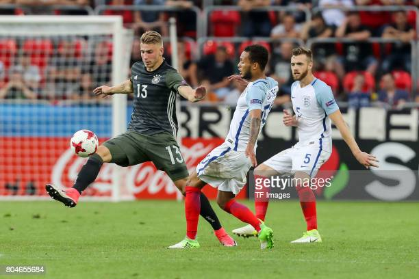 Felix Platte of Germany and Lewis Baker of England battle for the ball during the UEFA European Under21 Championship Semi Final match between England...