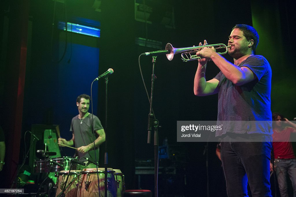 Felix Riebl and Harry James Angus of The Cat Empire perform on stage at Barts on July 15, 2014 in Barcelona, Spain.
