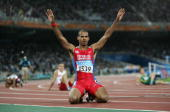 Felix Sanchez of Dominican Island celebrates after he won gold the men's 400 metre hurdle final on August 26 2004 during the Athens 2004 Summer...