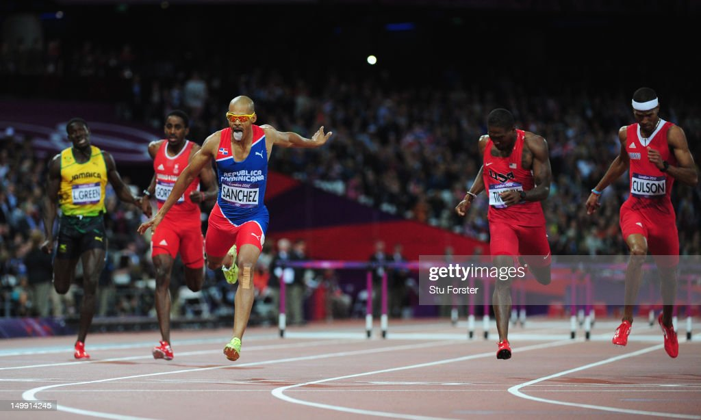 Felix Sanchez of Dominican Republic celebrates after winning the gold medal in the Men's 400m Hurdles final on Day 10 of the London 2012 Olympic...