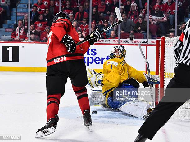 Felix Sandstrom of Team Sweden makes a save on Tyson Jost of Team Canada during the 2017 IIHF World Junior Championship semifinal game at the Bell...