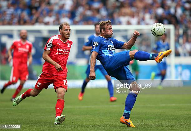 Felix Schiller of Magdeburg kicks the ball in front of Timo Furuholm of Halle during the Third League match between 1 FC Magdeburg and Hallescher FC...