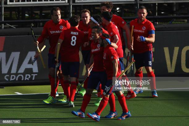 Felix Schues of Mannheimer HC celebrates scoring his teams second goal of the game with team mates during the Euro Hockey League KO16 match between...