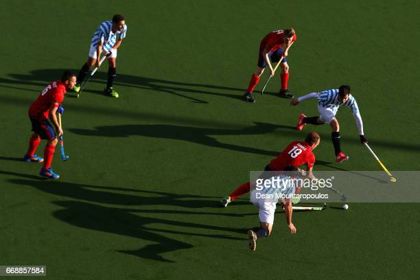 Felix Schues of Mannheimer HC gets past the tackles from Pau Quemada and Josep Lluis Novell of Club Egara during the Euro Hockey League KO16 match...
