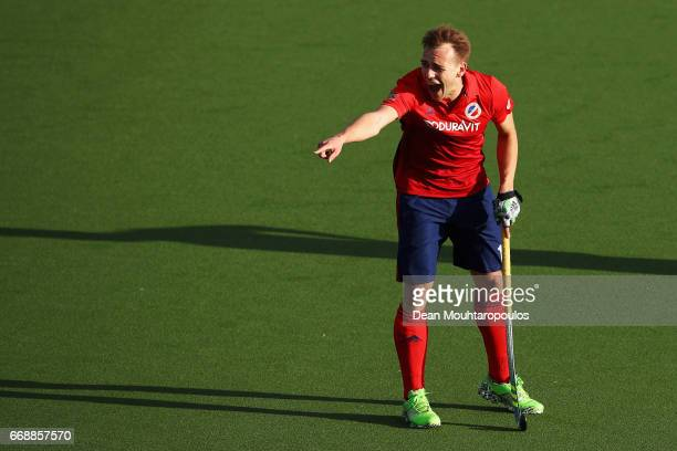Felix Schues of Mannheimer HC scream instructions to team mates during the Euro Hockey League KO16 match between Mannheimer HC and Club Egara at held...