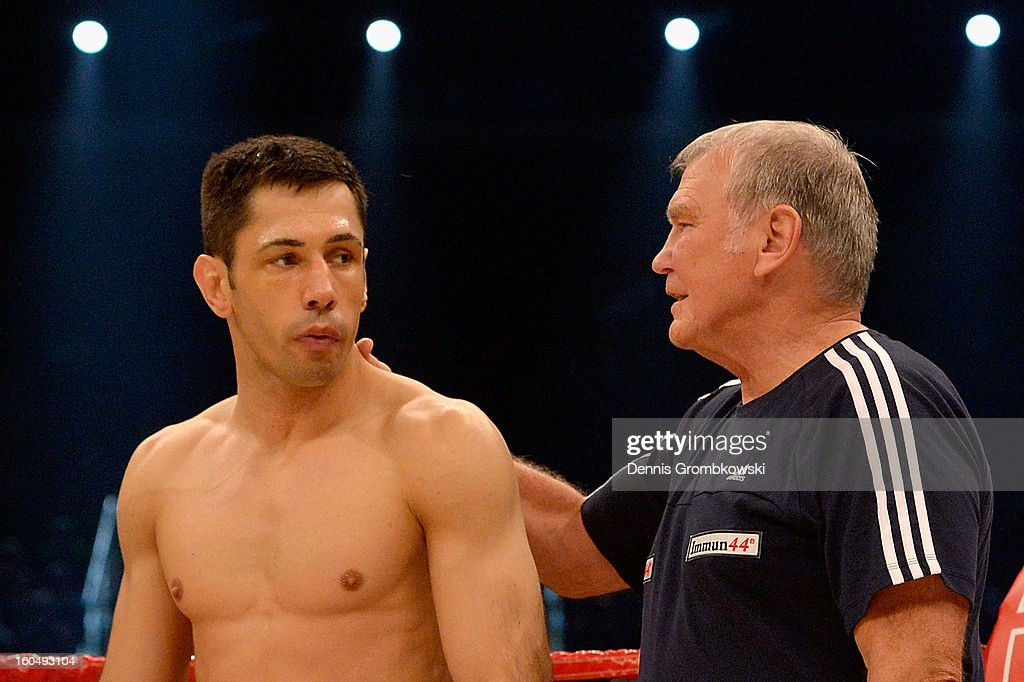 Felix Sturm of Germany and and coach Fritz Sdunek look on prior to the IBF Middleweight Eliminator fight against Sam Soliman of Australia at ISS Dome on February 1, 2013 in Duesseldorf, Germany.