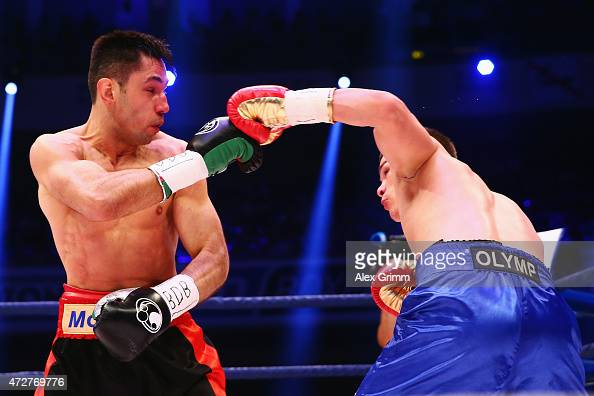 Felix Sturm of Germany and Fedor Chudinov of Russia exchange punches during their WBA super middle weight World Championship fight at Festhalle on...