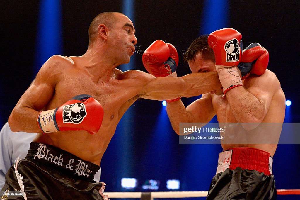 Felix Sturm of Germany and Sam Soliman of Australia box during their IBF Middleweight Eliminator fight at ISS Dome on February 1, 2013 in Duesseldorf, Germany.