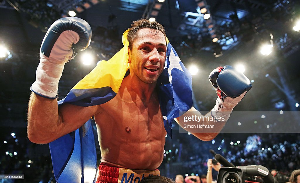 <a gi-track='captionPersonalityLinkClicked' href=/galleries/search?phrase=Felix+Sturm&family=editorial&specificpeople=171389 ng-click='$event.stopPropagation()'>Felix Sturm</a> of Germany celebrates winning after his IBF Middleweight World Championship fight against Darren Barker of England at Porsche Arena on December 7, 2013 in Stuttgart, Germany.