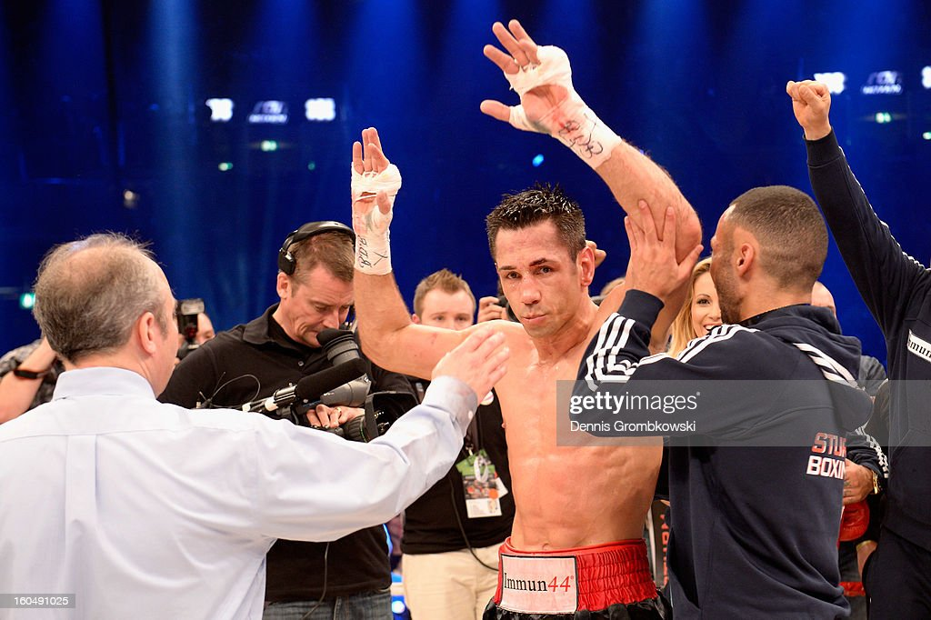 <a gi-track='captionPersonalityLinkClicked' href=/galleries/search?phrase=Felix+Sturm&family=editorial&specificpeople=171389 ng-click='$event.stopPropagation()'>Felix Sturm</a> of Germany reacts after his IBF Middleweight Eliminator fight against Sam Soliman of Australia at ISS Dome on February 1, 2013 in Duesseldorf, Germany.