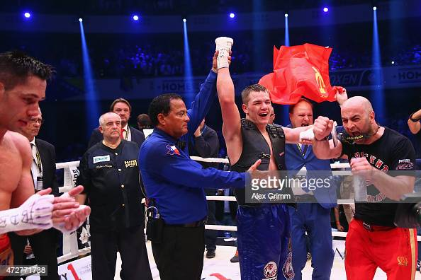 Felix Sturm of Germany reacts as Fedor Chudinov of Russia celebrates winning their WBA super middle weight World Championship fight at Festhalle on...