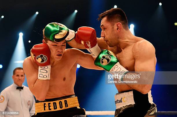 Felix Sturm of Germany throws a punch at Fedor Chudinov of Russia during the WBA Super Middleweight World Championship fight at KoenigPilsner Arena...