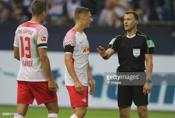 Felix Zwayer speak with Willi Orban of Leipzig and Stefan Ilsanker during the Bundesliga match between FC Schalke 04 and RB Leipzig at VeltinsArena...