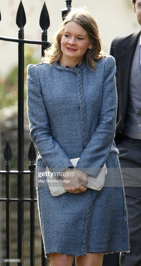 A fellow guest wears the same M Missoni coat as Catherine, Duchess of Cambridge as she attends the wedding of Lucy Meade and Charlie Budgett at the church of St Mary the Virgin, Marshfield on March 29, 2014 in Chippenham, England.