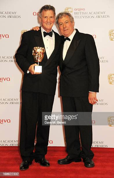 BAFTA Fellowship winner Michael Palin and presenter Terry Jones pose in the press room at the Arqiva British Academy Television Awards 2013 at the...
