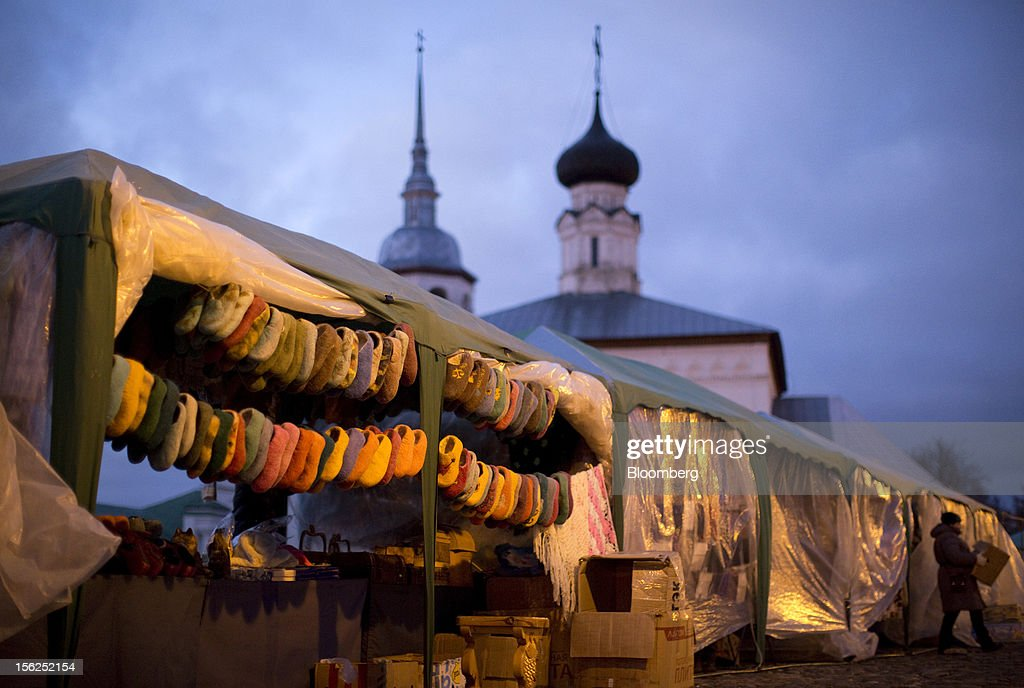Felt slippers hang for sale from a market stall in Suzdal, Russia, on Saturday, Nov. 10, 2012. Russia has one of the world's lowest retirement ages, set in 1932 during the Stalin era. Photographer: Andrey Rudakov/Bloomberg via Getty Images