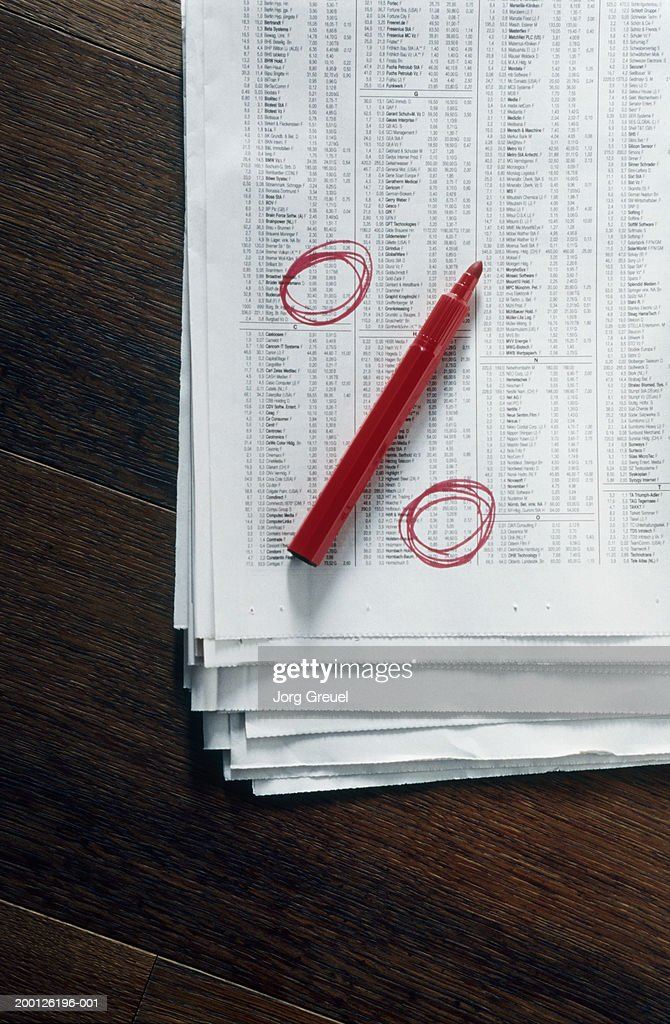 Felt tip pen and drawn circles forming percentage sign on newspaper : Stock Photo