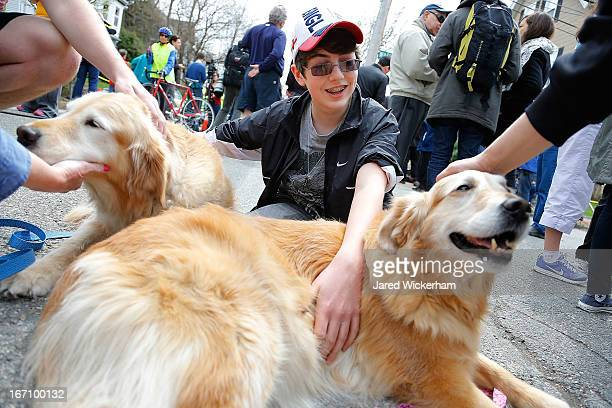 Feltner Harrison who lives on nearby Parker Street in Watertown and witnessed the initial shots fired pets two certified therapy dogs Archie and Diva...