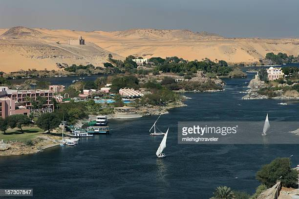 Felucca boats on Nile River by Sahara desert Aswan Egypt