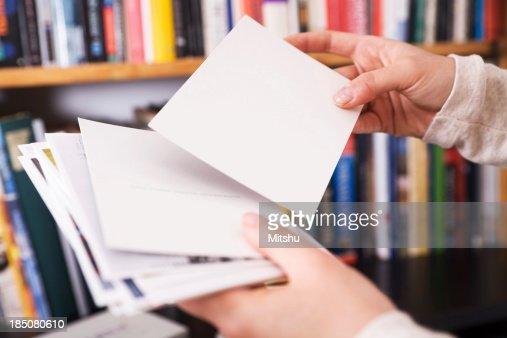 Femal hands holding postcards
