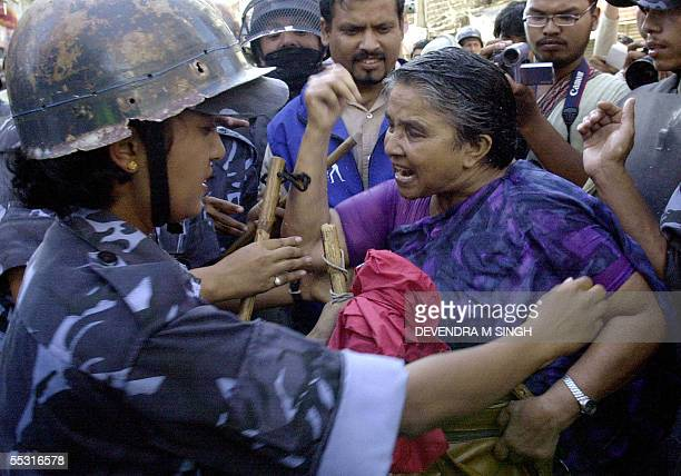 A female activist argues with riot police at an antiKing street protest on the fifth consecutive day in the restricted area of Kathmandu 08 September...
