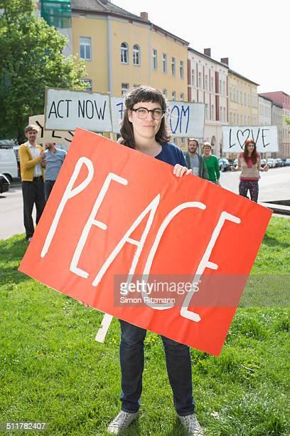 Female activist demonstrating for peace