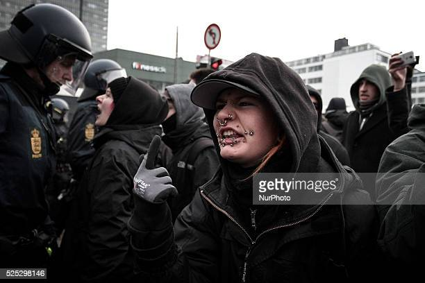 A female activists yells in disgust seconds after police officers have knocked a fellow activist unconscious Clashes between antiislamist protesters...