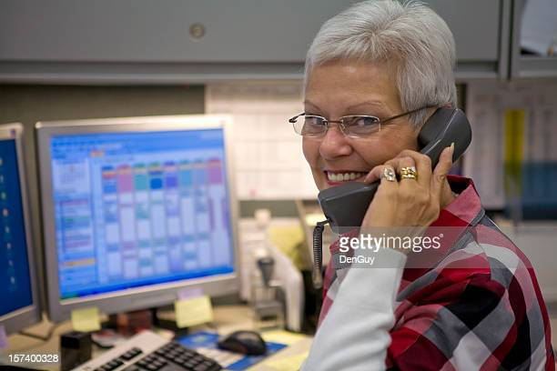 Female administrative specialist on the phone