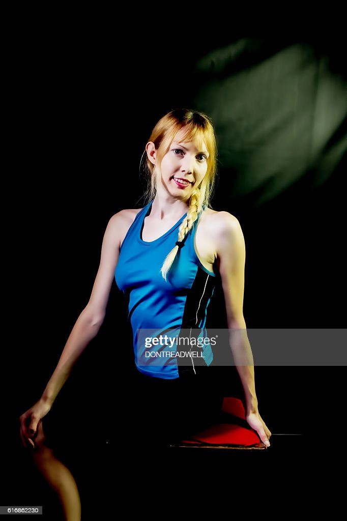 Female Adult Posing In Her Yoga Clothes : Stock Photo