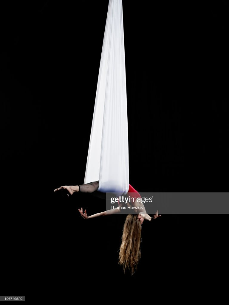 Female aerialist performing on suspended silk : Foto stock