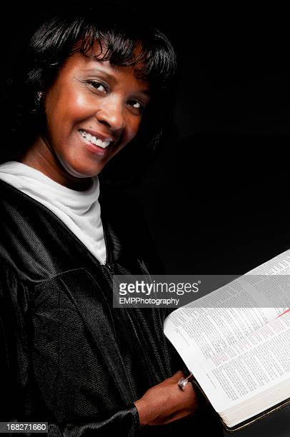 Female African American Pastor Isolated on Black