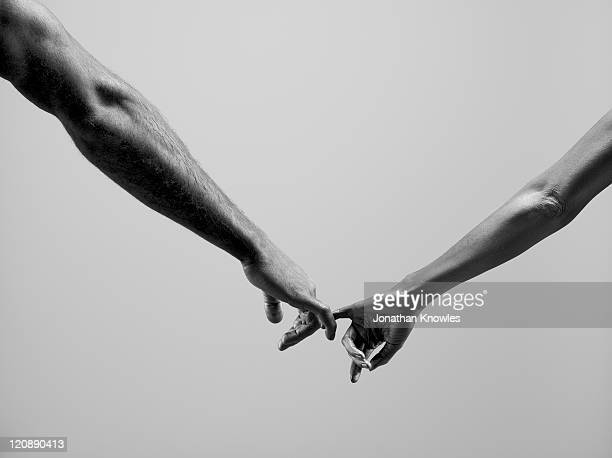 Female and male connecting by fingers