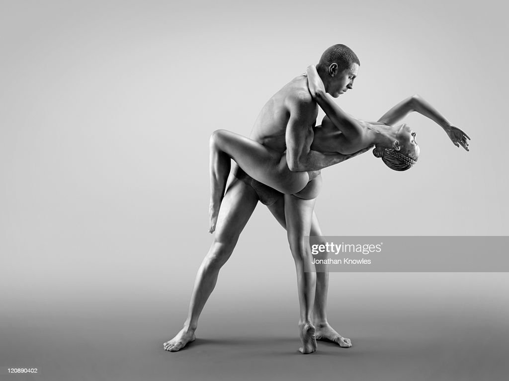 Female and male in paint : Stock Photo